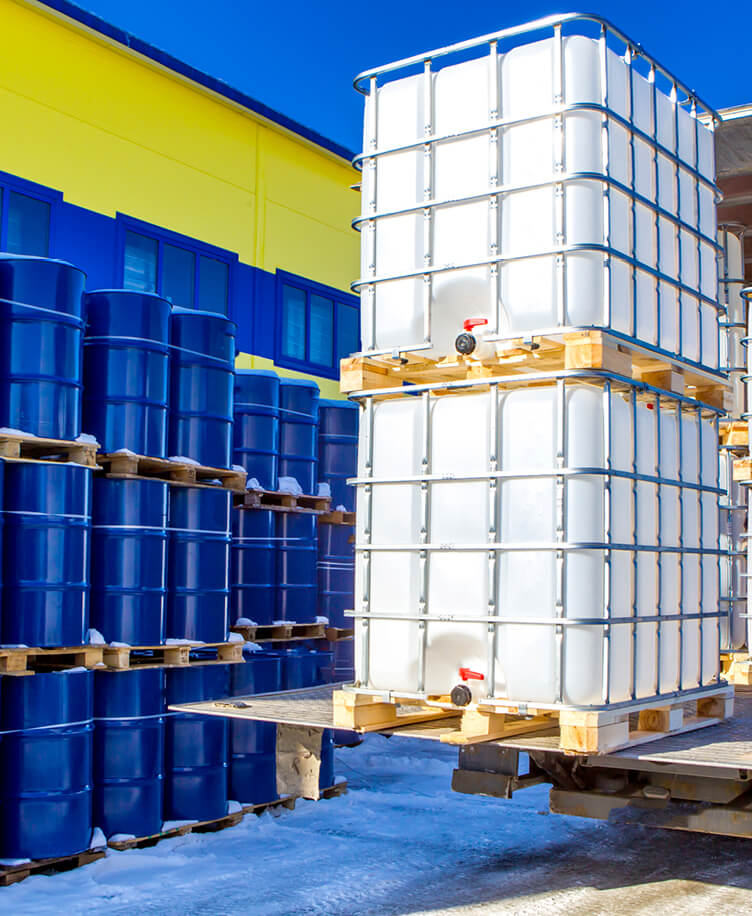 Image of chemical containers on a forklift.