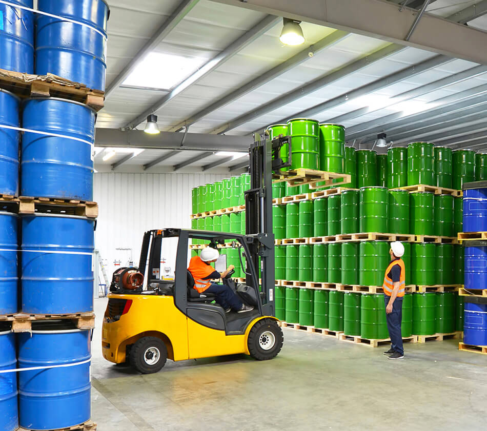 Image of forklifts and chemical containers