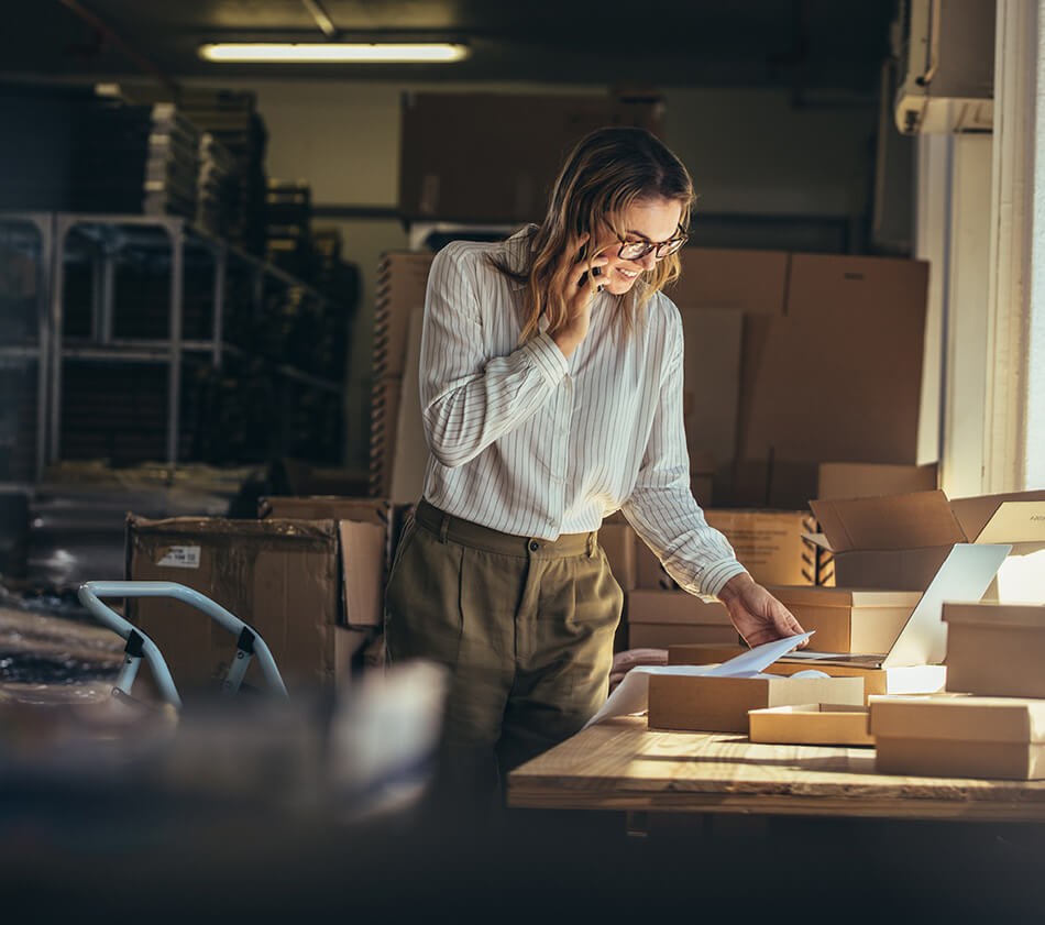 Image of woman in distribution center for ecommerce store.