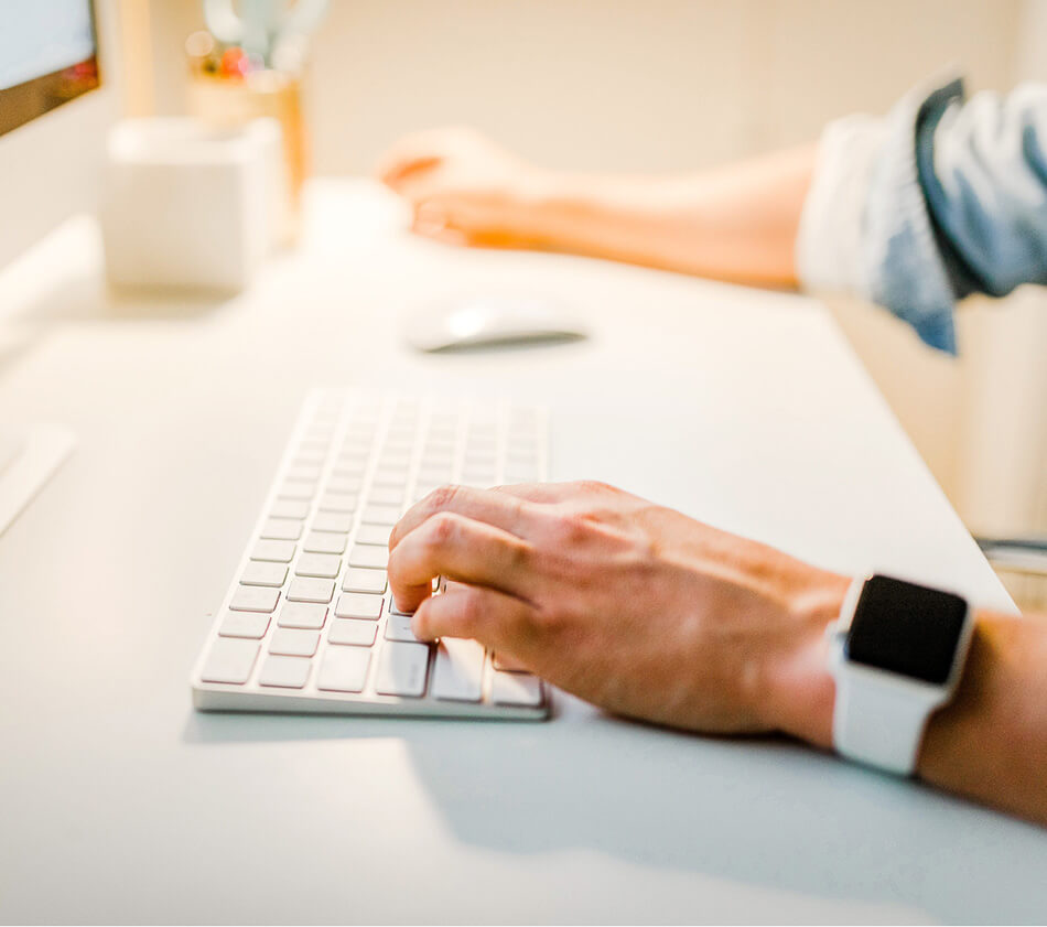 Image of a person typing on a keyboard.