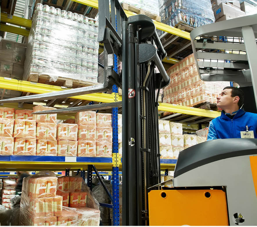 Image of warehouse worker driving a forklift with a Sobel name tag.